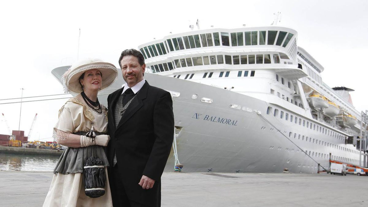 Mary Beth Crocker Dearing and her husband Tom Dearing from Newport Ky. pose for the media in period costume as they wait to board the MS Balmoral cruise ship in Southampton, England, Sunday, April 8, 2012.