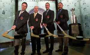 Hockey Hall of Fame inductees (left to right) Doug Gilmour, Mark Howe, Joe Nieuwendyk and Ed Belfour pose with sticks and pucks after being presented with their jackets and rings at the Hall in Toronto on Monday November 14, 2011.