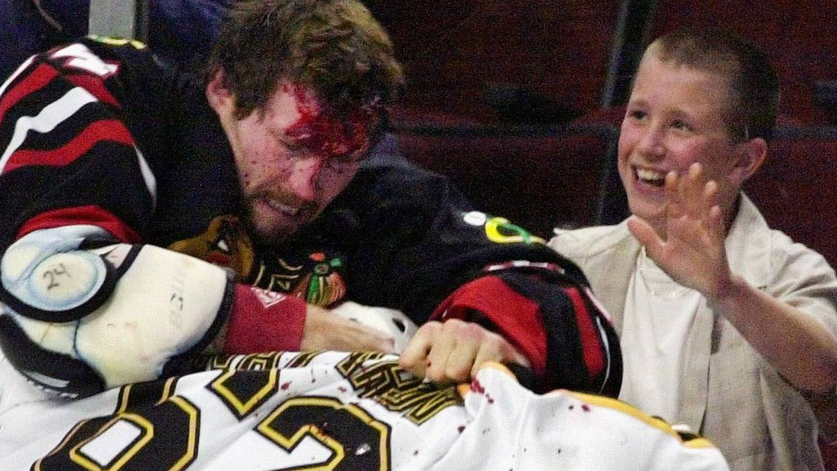 Chicago Blackhawks' Bob Probert (24) and Boston Bruins' Andrei Nazarov (62) of Russia, mix it up along the boards during a first period fight Sunday, Oct. 28, 2001 in Chicago. Both players received five minute penalties for fighting. (AP Photo/Fred Jewell)