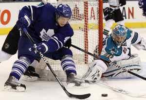 San Jose Sharks goalie Evgeni Nabokov, right, makes a save on Toronto Maple Leafs' Nikolai Kulemin during second-period NHL hockey action in Toronto, February 8, 2010.