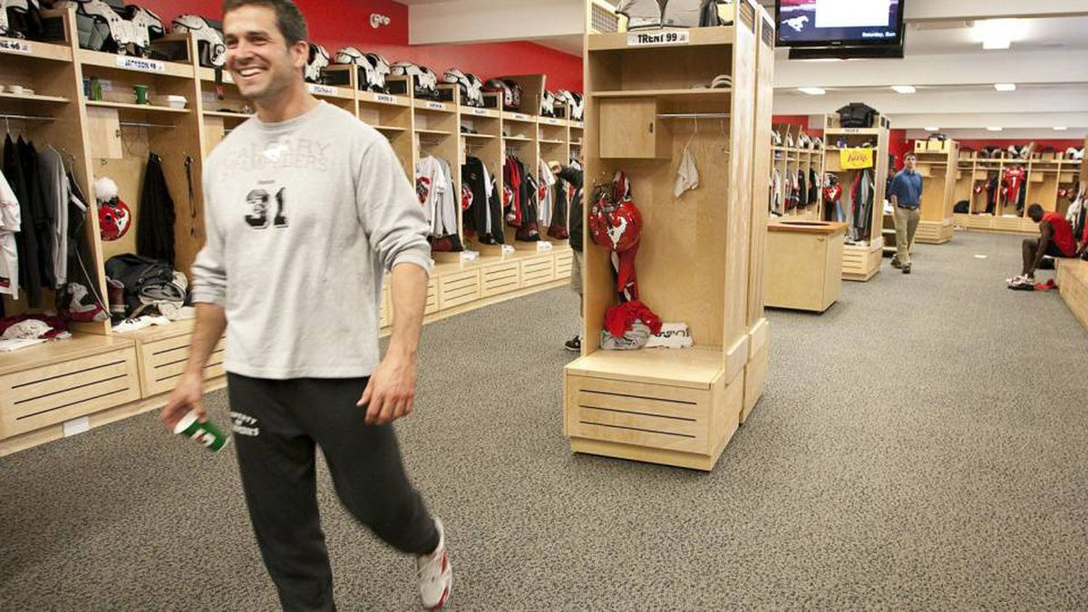 Calgary Stampeders Wes Lysack walks through the locker room during a media tour of the team's new facilities in Calgary, Monday, June 14, 2010.