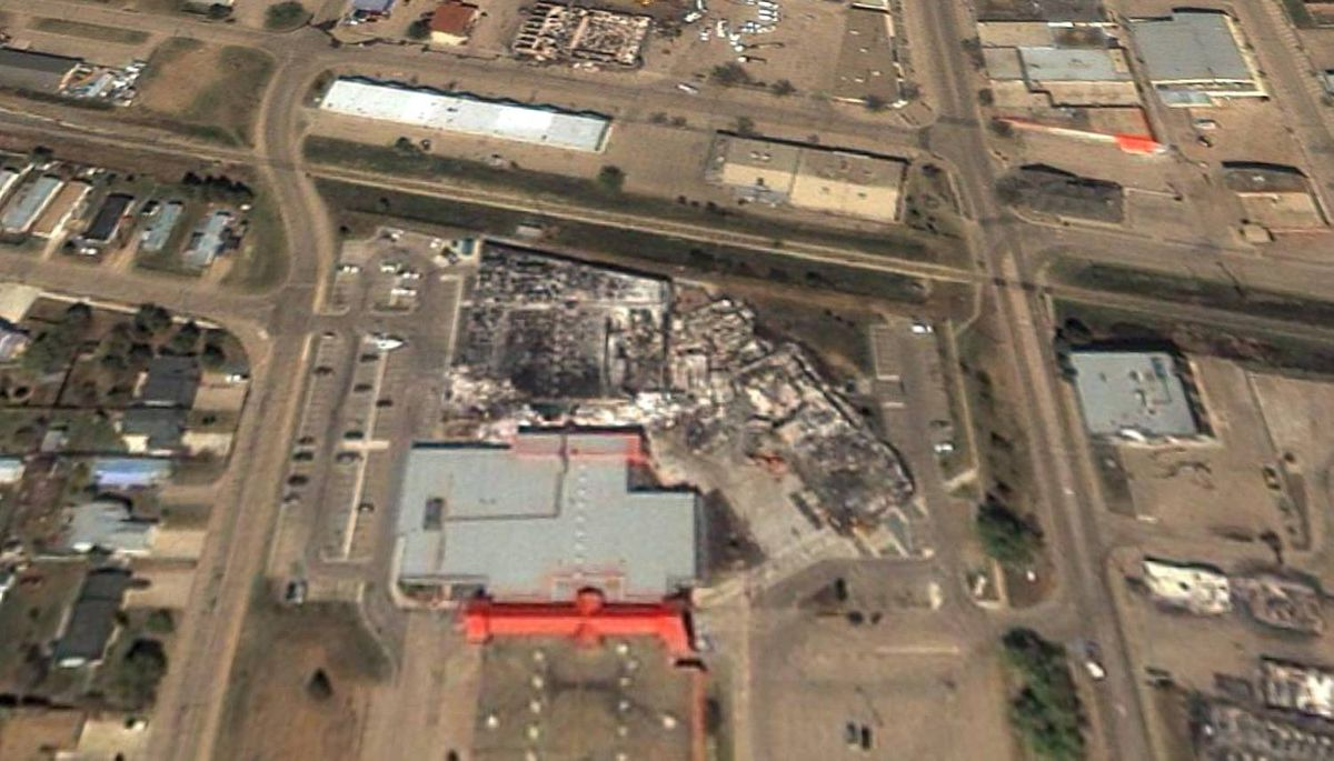 City Hall in Slave Lake Alberta after a forrest fire ripped through the area in this recent satalite image. GeoEYE/Google