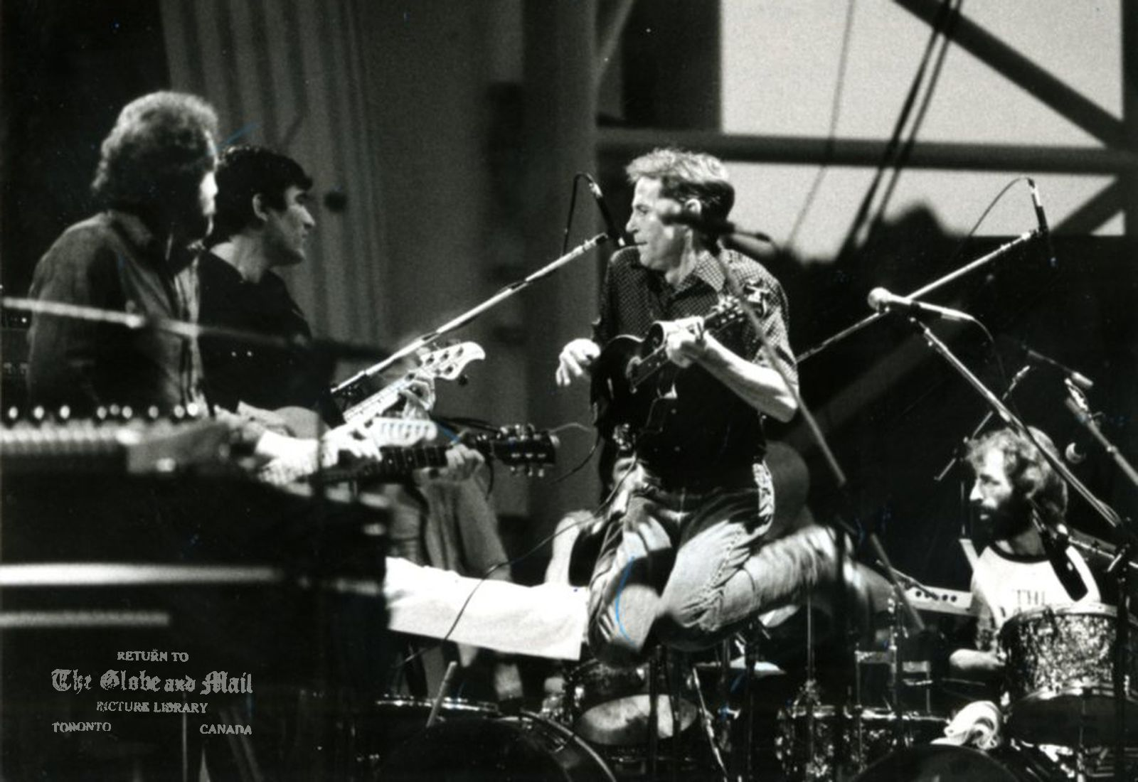 Levon Helm of The Band jumps into the air while Richard Manuel fills in on the drums July 4, 1983. Credit: Thomas Szlukovenyi / The Globe and Mail Orig. Pub. July 5, 1983