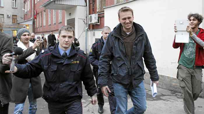 Prominent anti-corruption blogger Alexei Navalny (centre) arrives for an appeal hearing at a court in Moscow Dec. 7, 2011.