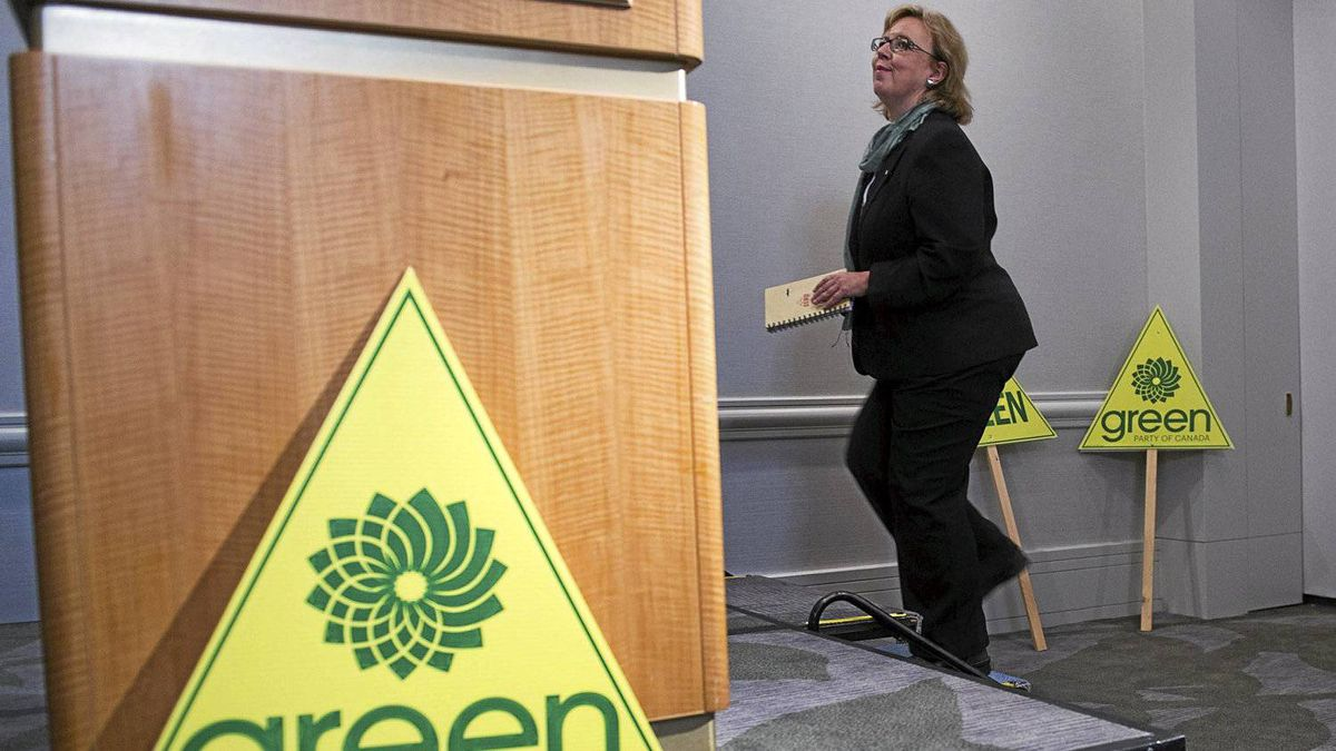 Green Party leader Elizabeth May takes the podium to comment on her exclusion from the televised leaders debate during the Canadian federal election, in Vancouver, British Columbia March 30, 2011.