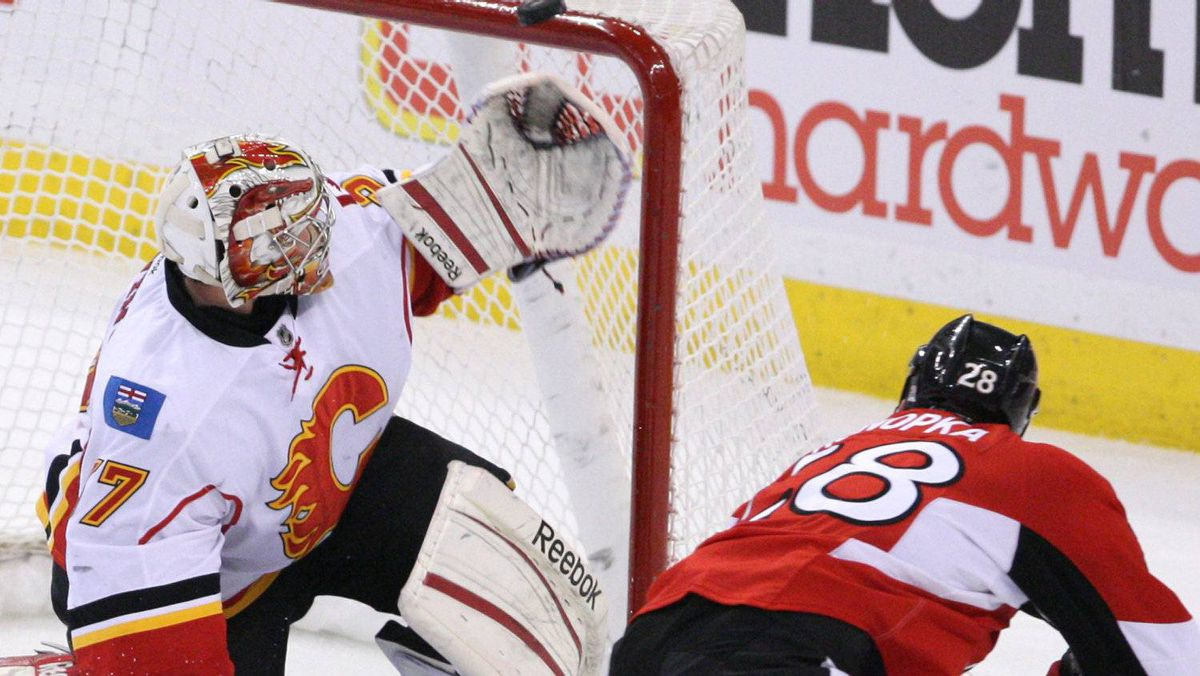 Calgary Flames goaltender Leland Irving (37) watches as Ottawa Senators Zenon Konopka's (28) shot goes over the crossbar during second period NHL hockey action in Ottawa Friday December 30, 2011. THE CANADIAN PRESS/Fred Chartrand