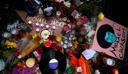Fans make a shrine for the late pop star Michael Jackson on his star on the Hollywood Walk of Fame in Los Angeles, California.