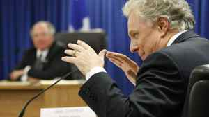 Quebec Premier Jean Charest testifies at the Inquiry Commission into the appointment process for judges Thursday, September 23, 2010 in Quebec City. Commissioner Michel Bastarache, behind, looks on.