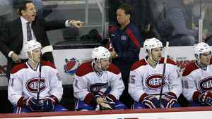 al Canadiens coach Jacques Martin, rear left, shouts to his players during the third period of an NHL hockey game against the New Jersey Devils in Newark, N.J., Saturday, Dec. 10, 2011. The Canadiens won 2-1. (AP Photo/Mel Evans)