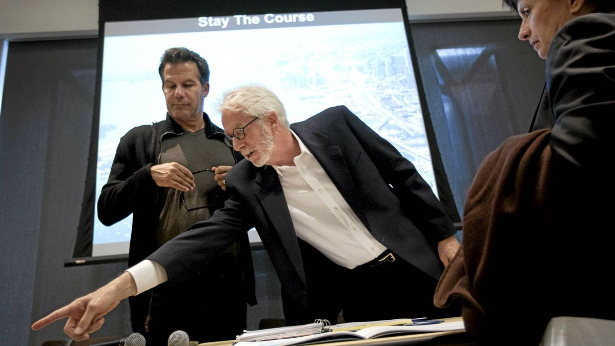 Former chief planner for Toronto Paul Bedford, centre, and Richard Florida of the Martin Prosperity Institute, left, two principal authors of a letter opposing Mayor Ford's waterfront plans, confer prior to a press conference at the Toronto Reference Library in Toronto, Thursday, Sept. 15, 2011.
