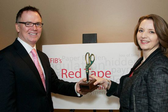 B.C. Finance Minister, Kevin Falcon receiving the Golden Scissors Award from Laura Jones, CFIB Sr. Vice-President, Economic and Western Canada