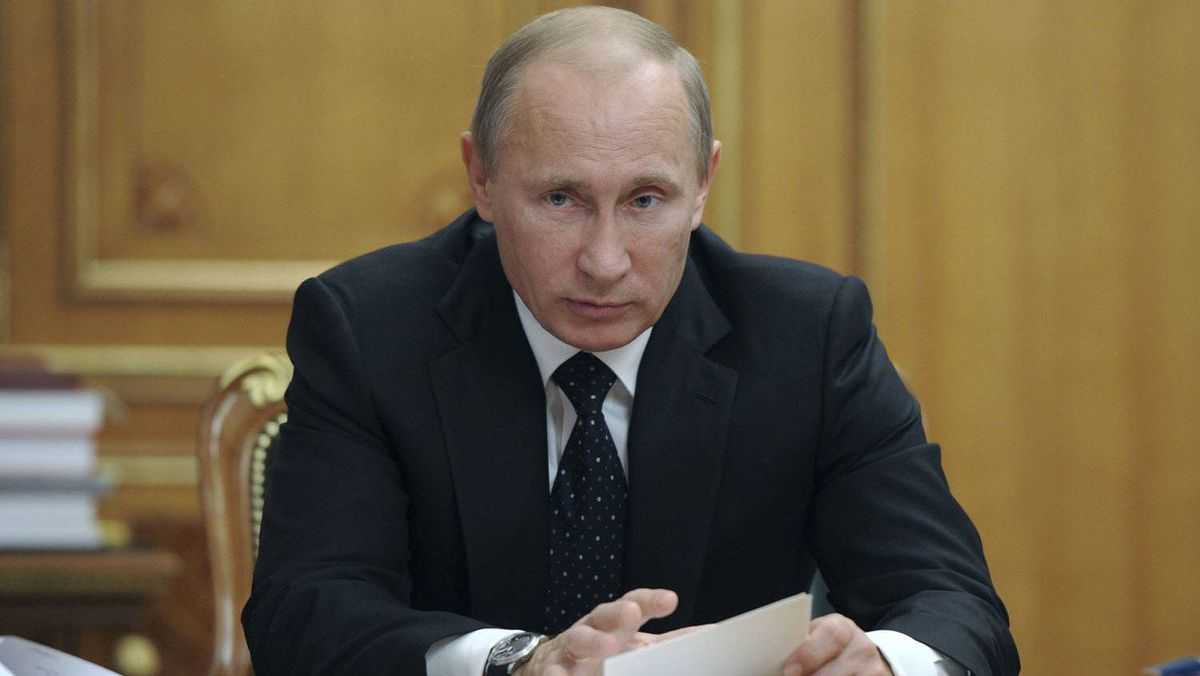 Russian Prime Minister Vladimir Putin chairs a meeting on the defensive-industrial complex on his 59th birthday in Moscow October 7, 2011.