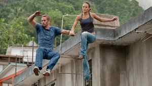 """Paul Walker and Mia Toretto leap into action in a scene from """"Fast Five."""""""