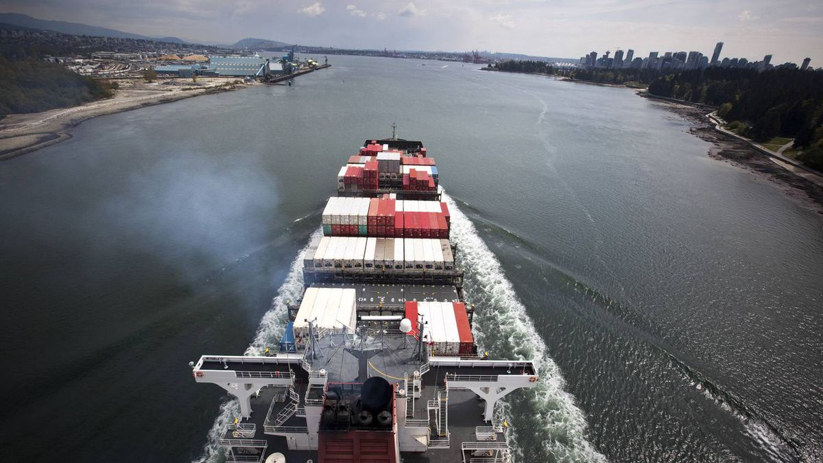 A container ship makes its way toward the Port of Vancouver