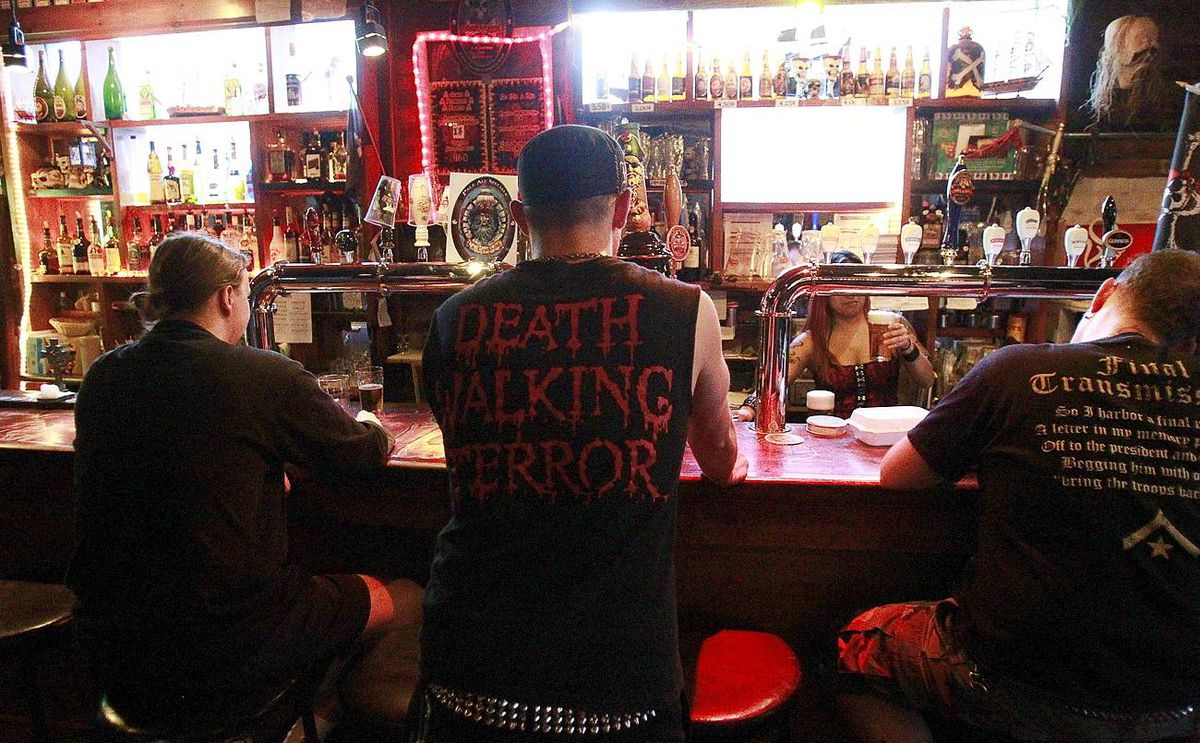 Montreal, May 21, 2010-- Talk Sick band members Jesse orders a beer while they wait to perform in Montreal, May 21, 2010. Christinne Muschi for the Globe and Mail