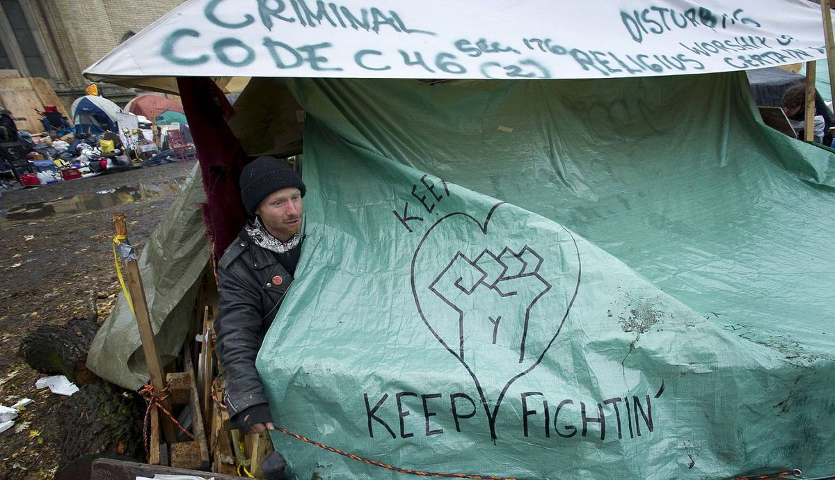Police moved into St. James Park to evict Occupy Toronto protester in Toronto, Ont. Nov. 23/2011. Things remained peaceful as city workers began dismantling the tents and structures. Photo by Kevin Van Paassen/The Globe and Mail