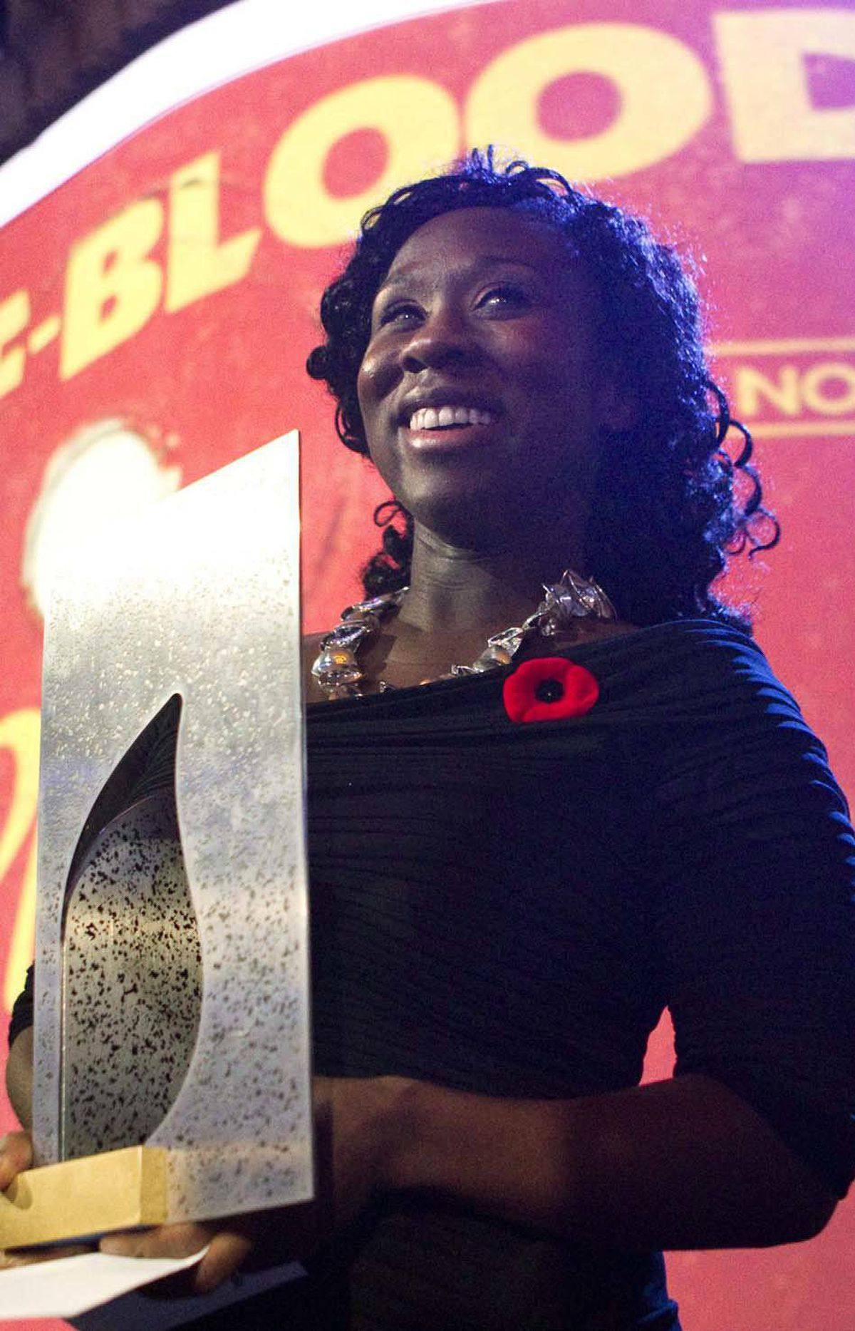 The triumphant Esi Edugyan holds the Giller Prize, which comes with a $50,000 cheque and a guaranteed surge in book sales.