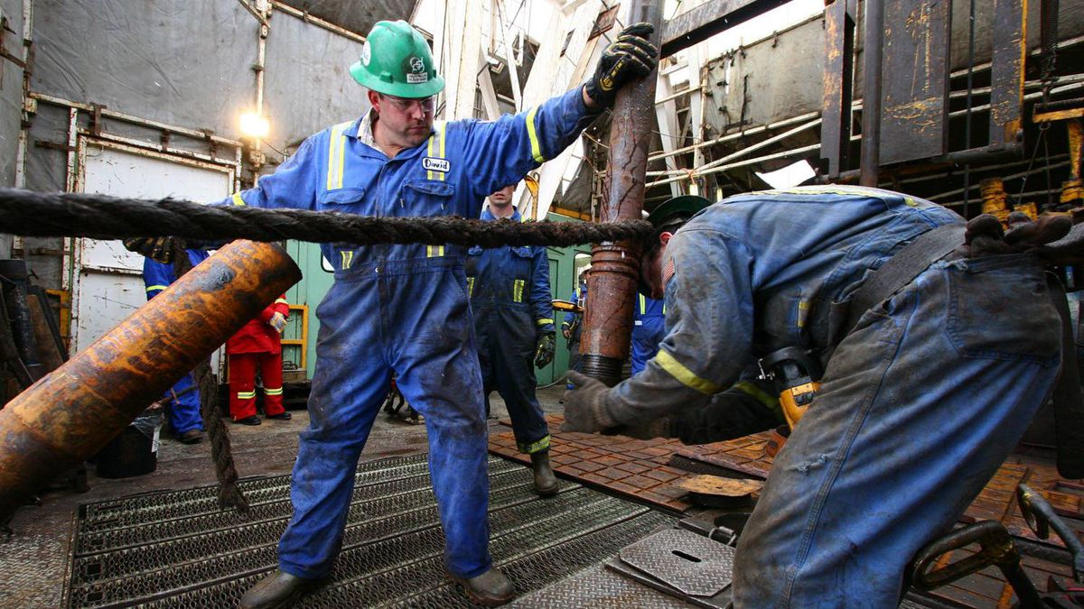 Workers tap deep into North Dakota's Bakken formation, on a Precision Drilling rig.