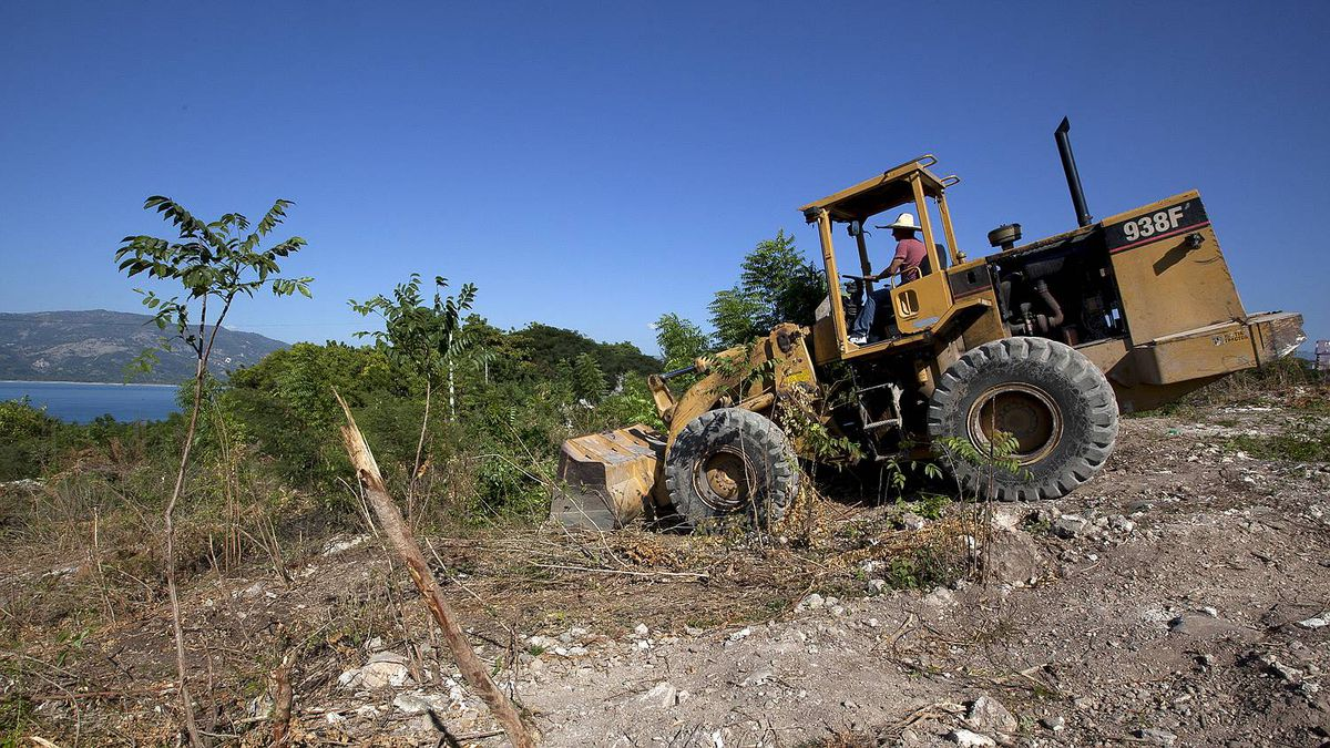 Joel Khawly works the payloader to clear a new construction site where he plans to build a small resort.