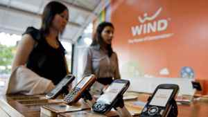 Customers shop at a Wind Mobile retail store in Toronto on Aug. 26, 2010.