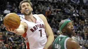 Toronto Raptors forward Andrea Bargnani puts up a shot against Boston Celtics forward Jermaine O'Neal (R) during the first half of their pre-season NBA basketball game in Toronto December 18, 2011. REUTERS/Mike Cassese