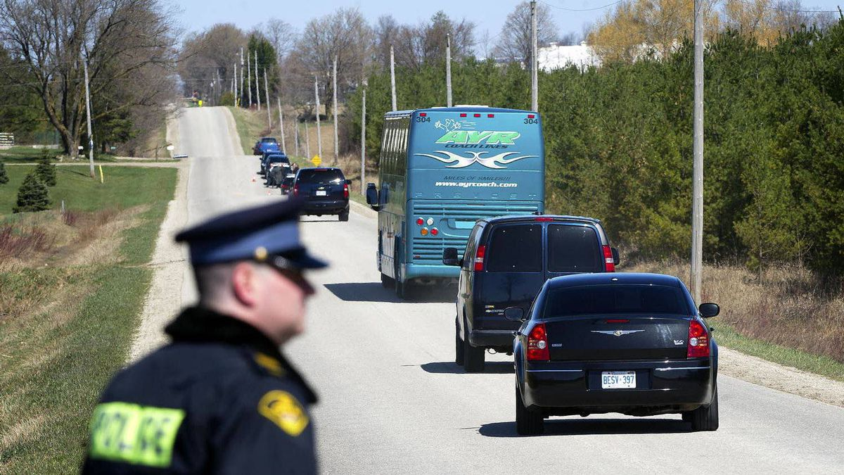 Members of the jury in the Michael Rafferty trial arrive by bus at the site where Tori Stafford's body was found near Mount Forest, Ont., on April 2, 2012.