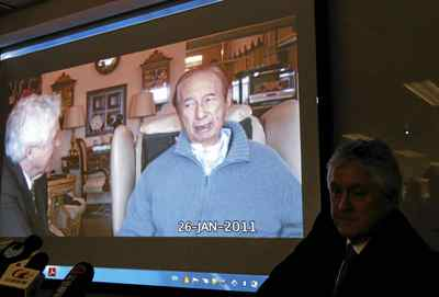 Lawyer Gordon Oldham, right, shows his video of the conversation with Hong Kong casino tycoon Stanley Ho