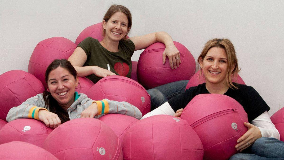 Ugi Fitness co-founders Sara Shears, Deb Karby and Melanie Finkleman, and their Ugi ball