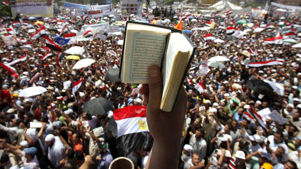 An Egyptian protester holds up a Koran while participating in a rally at Tahrir square in Cairo July 29, 2011.