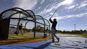 Toronto Blue Jays infielder Brett Lawrie (R) and teammate Mike McCoy take batting practice at the Florida Auto Exchange Stadium, their MLB American League spring training facility, in Dunedin, Florida February 12, 2011. REUTERS/ Mike Cassese