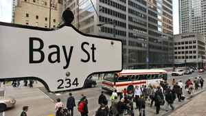 The Bay Street sign is pictured in the heart of the financial district as people walk by in Toronto.