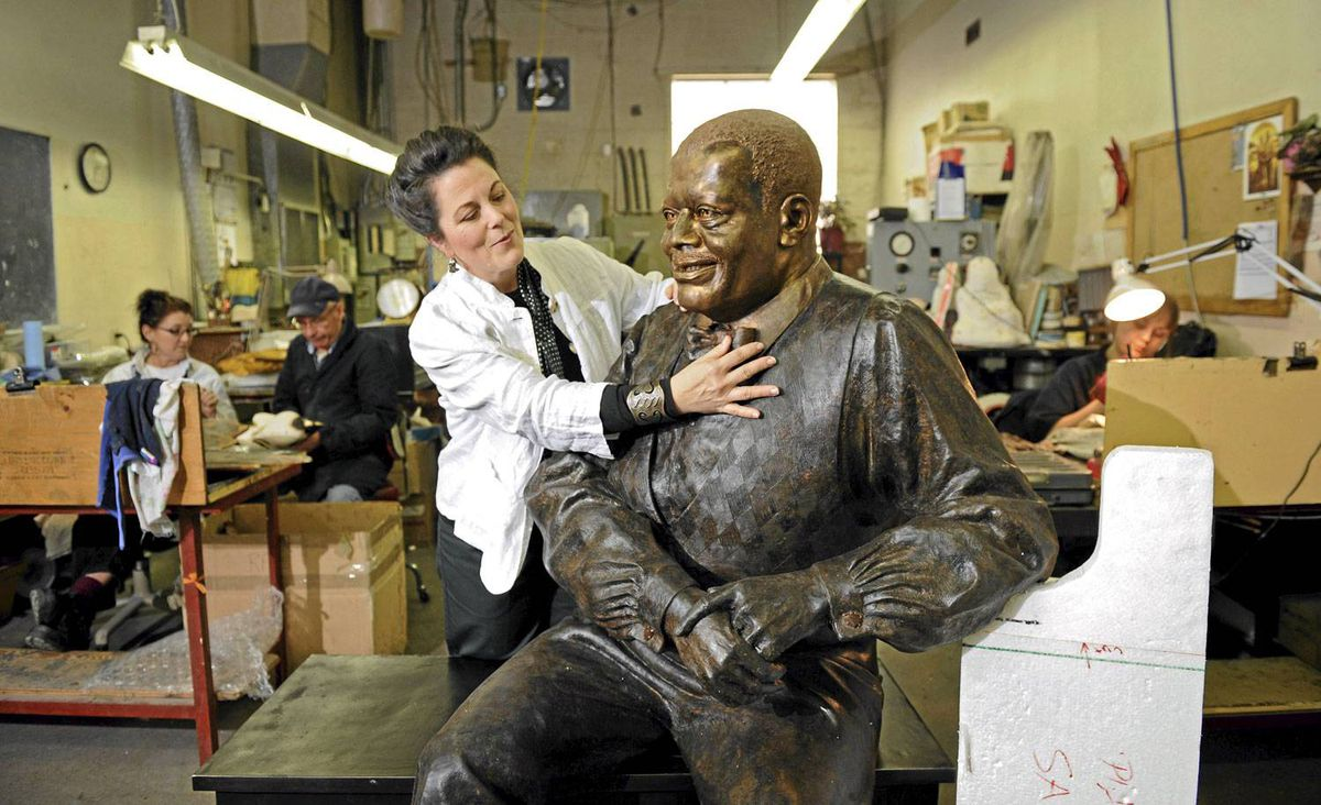 Ruth Abernethy, the sculptor who did the famous Glenn Gould statue, has been commissioned to do a statue of Oscar Peterson for the National Arts Centre in Ottawa. Abernethy is photographed at Artcast inc. where her sculpture is being cast.
