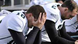 Jacksonville Jaguars kicker Josh Scobee (10) and punter Nick Harris (2) sit on the bench in the fourth quarter of an NFL football game against the Tennessee Titans on Saturday, Dec. 24, 2011, in Nashville, Tenn. The Titans won 23-17. (AP Photo/Frederick Breedon)