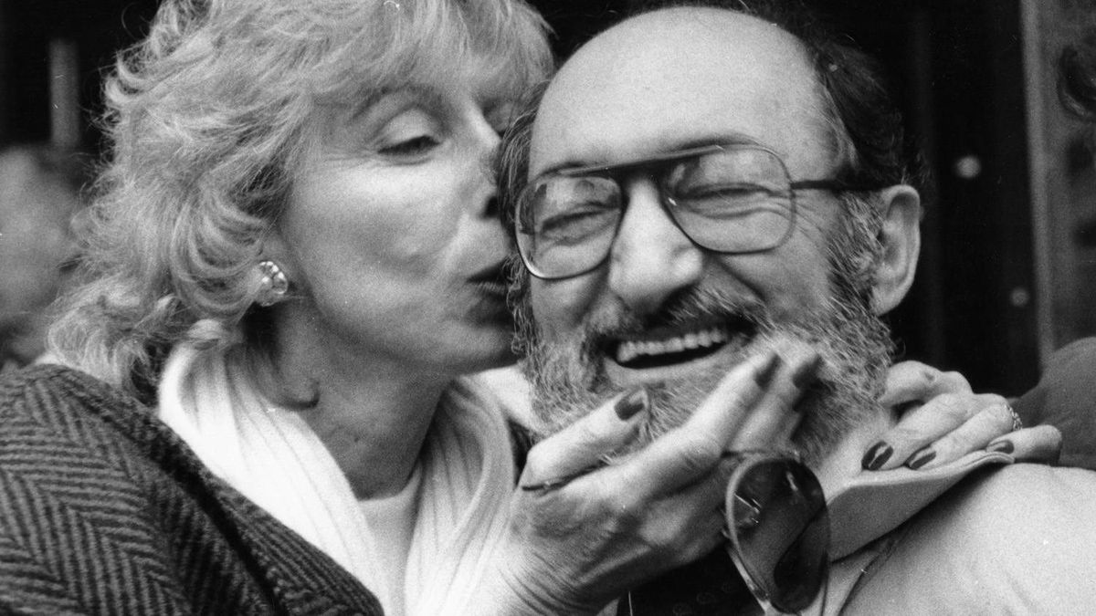 "November 8, 1984--Dr. Henry Morgentaler, right, gets a kiss from supporter Selma Edelstone in Toronto after he and his associates were acquitted. Henry Morgentaler and two associates made Ontario legal history on November 8, 1984 when a Supreme Court of Ontario jury acquitted them of breaking an abortion law. The jubilant Dr. Morgentaler immediately joined supporters outside the courthouse, howling in delight and delivering an off-key rendition of a modified victory song, ""We have overcome."""