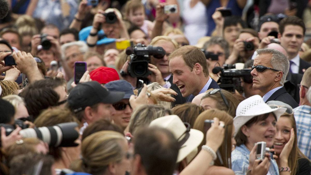 Prince William greets the crowd following a ceremony at the Canadian War Memorial Thursday, June 30, 2011 in Ottawa.