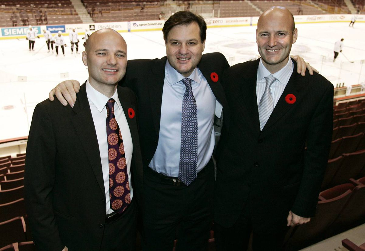 The Aquilini Investment Group owned by, from left Paolo, Francesco and Roberto Aquilini pose for pictures in GM Place.
