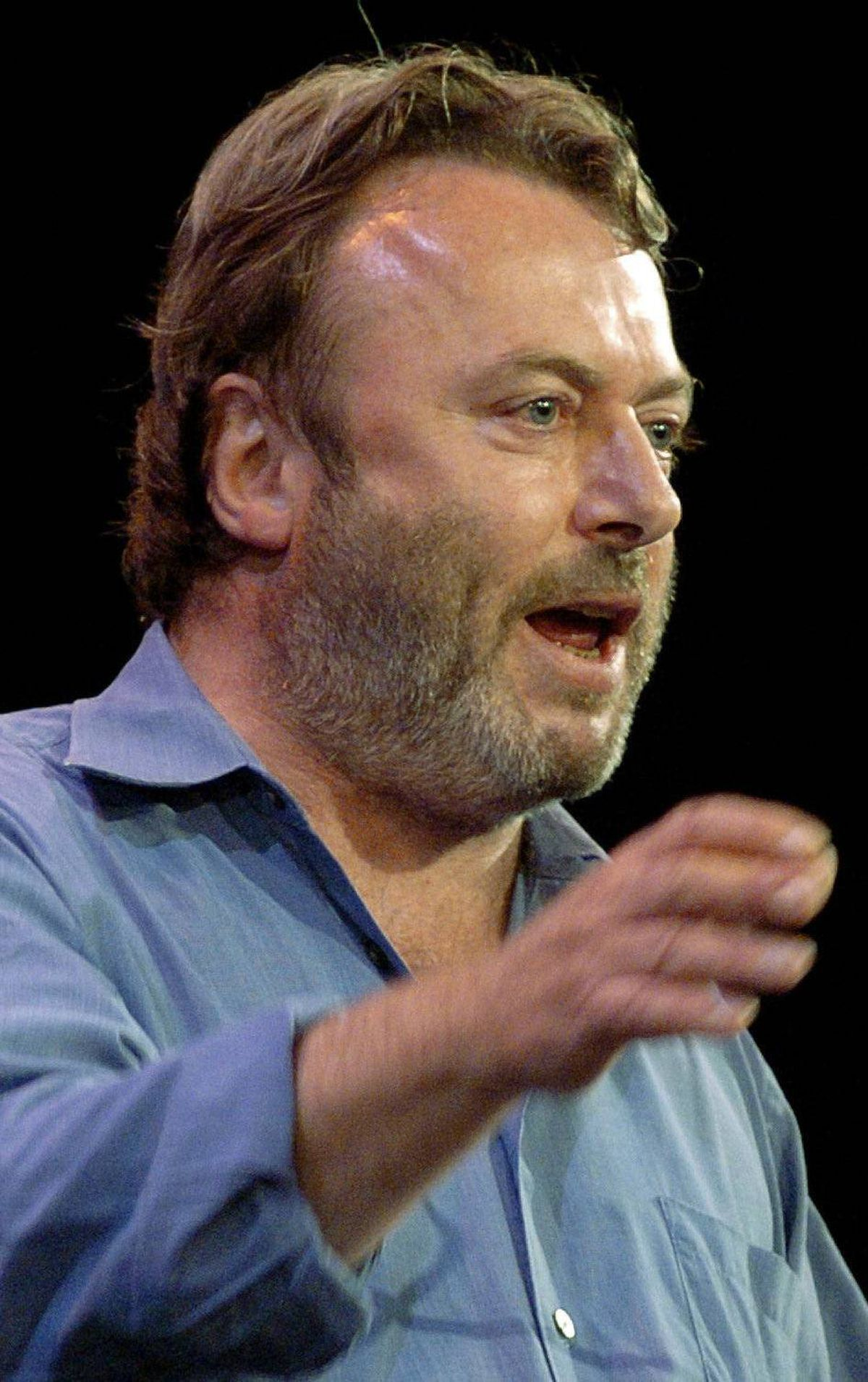 """**FILE**Essayist Christopher Hitchens speaks during a debate on Iraq and the foreign policies of the United States and Britain, on Sept. 14, 2005 in New York. The title of his new book, """"God Is Not Great,"""" is an intentionally inflammatory twist on """"Allah Akbar."""" Indeed, he lambasts Islam as """"not much more than a rather obvious and ill-arranged set of plagiarisms"""" from Judaism and Christianity. (AP Photo/Chad Rachman)"""