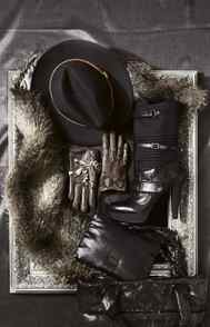 TREND: BLACK Club Monaco hat, $98.50 Club Monaco faux-fur scarf, $98.50 Nine West boots, $225 Nine West bag and pocketbook, $130. Imoni python gloves, $235 at Intermix in Toronto.