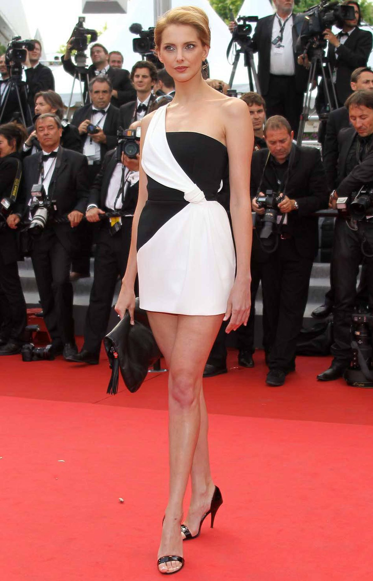 "French actress Frederique Bel poses on the red carpet for ""La Piel Que Habito"" at the Cannes Film Festival on Thursday."