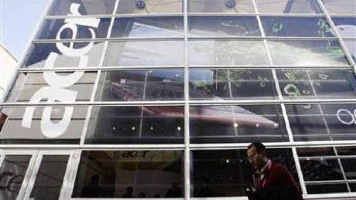 A man walks past an 'Acer' office during the Mobile World Congress in Barcelona February 18, 2010 file photo.
