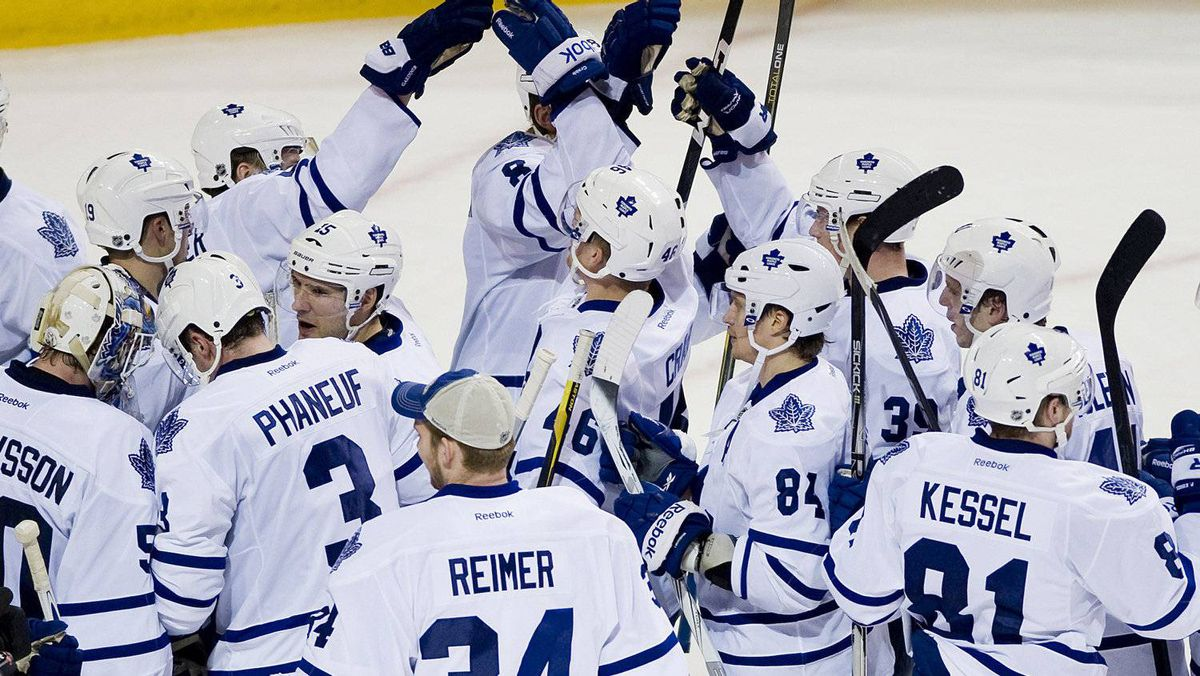 Toronto Maple Leafs players celebrate after beating the Montreal Canadiens in NHL hockey game action in Montreal, Saturday, March 3, 2012. THE CANADIAN PRESS/Graham Hughes