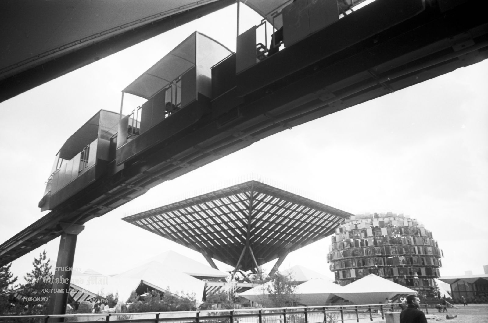 MONTREAL -- EXPO 67 -- View of the fairgrounds prior to opening, April 24, 1967. Exterior view of the Canadian Pavilion (a large inverted pyramid called the Katimavik, which is the Inuit word for