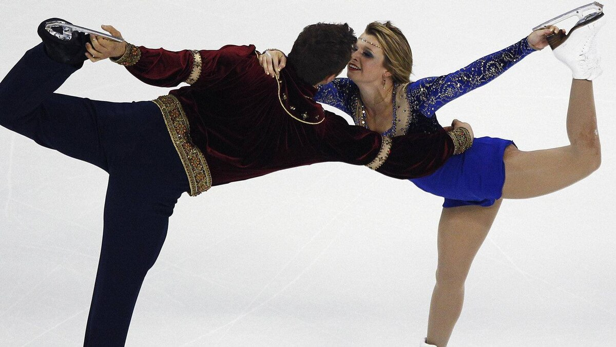Kirsten Moore-Towers and Dylan Moscovitch of Canada compete during the pairs free skating program at the Cup of China ISU Grand Prix of Figure Skating in Shanghai November 5, 2011. REUTERS/Carlos Barria