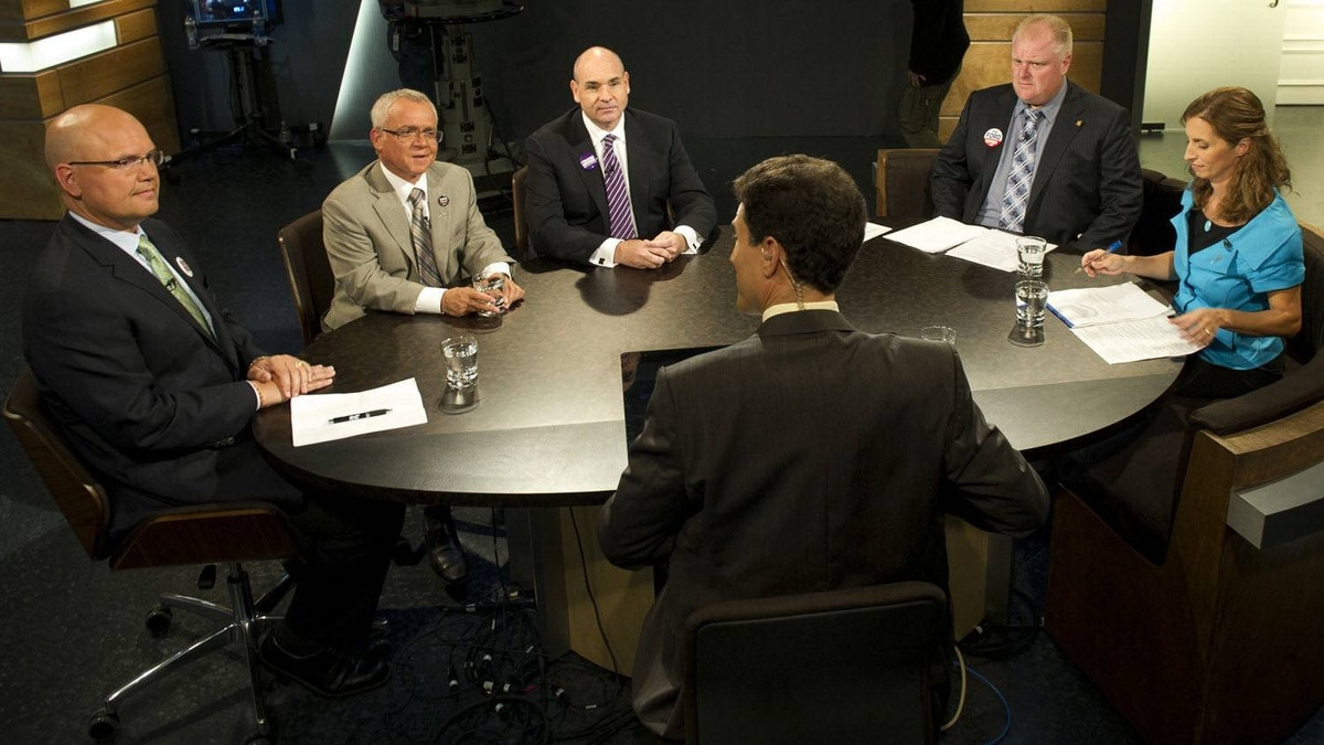 Mayoral candidates, clockwise from left, Rocco Rossi, Joe Pantalone, George Smitherman, Rob Ford and Sarah Thomson photographed during an earlier debate.