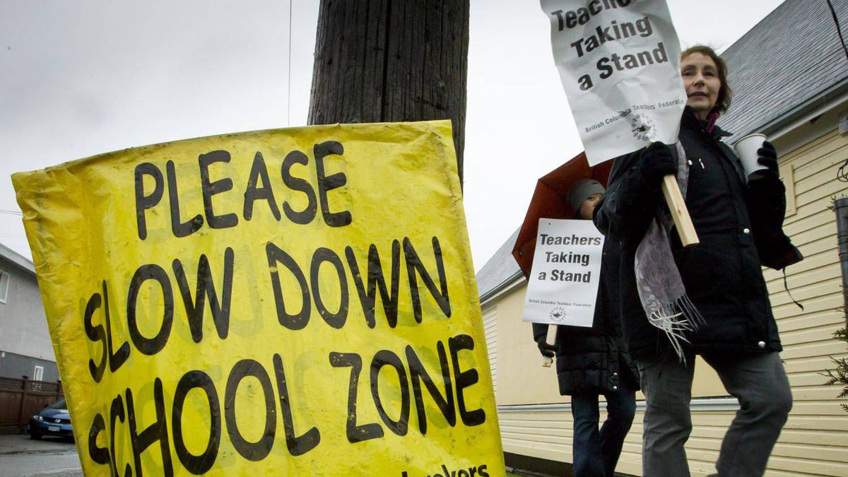 Teachers walk an information picket line at Sir Guy Carleton school in Vancouver on March 5, 2012.