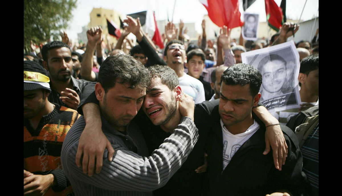 Family members mourn during a funeral for slain anti-government protester Ali Ahmed al Muameen on Feb. 18, 2011 in Sitra, Bahrain.
