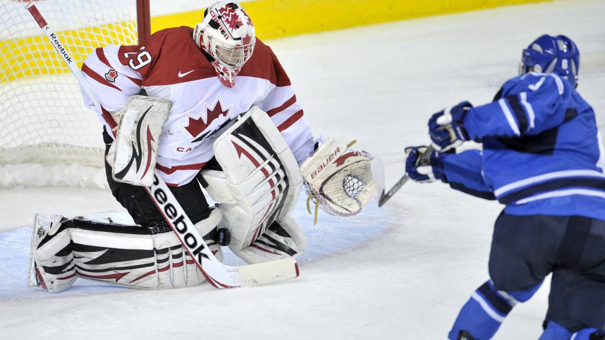 Canada's Mark Visentin stops a penalty shot from Teemu Pulkkinen in the second period.