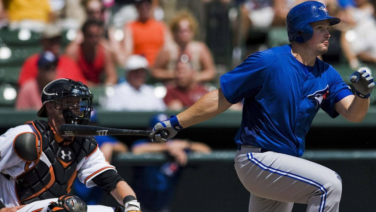 Baltimore Orioles catcher Matt Wieters (L) looks on as Toronto Blue Jays' Travis Snider (R) doubles off Baltimore starter Tommy Hunter during the second inning of a spring training baseball game in Sarasota, Florida, March 21, 2012. REUTERS/Steve Nesius