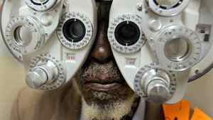 An South African man has his eyes tested inside the Phelophepa medical train at the rural Kirkwood railway station in Eastern Cape province on Jan. 24, 2006.