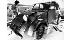 This 1938 Citroen 2CV prototype was a star attraction at the 1973 Frankfurt Auto show. Like the Ford Model T and the VW Beetle, the 2CV was a true people's car, designed for low cost and simple repair. Some afficionados claimed that the only tool kit required for a 2CV was a screwdriver, a pair of pliers, and a length of wire.